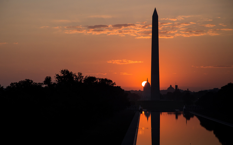 Washington Monument and reflection at sunset